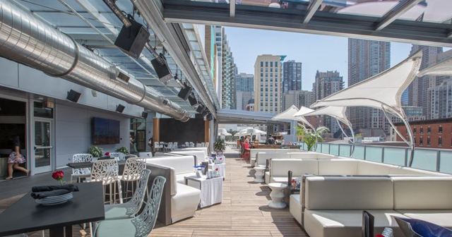 Inside look of IO Godfrey Rooftop with bottle service