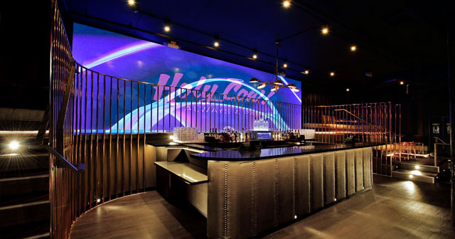 Inside look of Holy Cow with bottle service